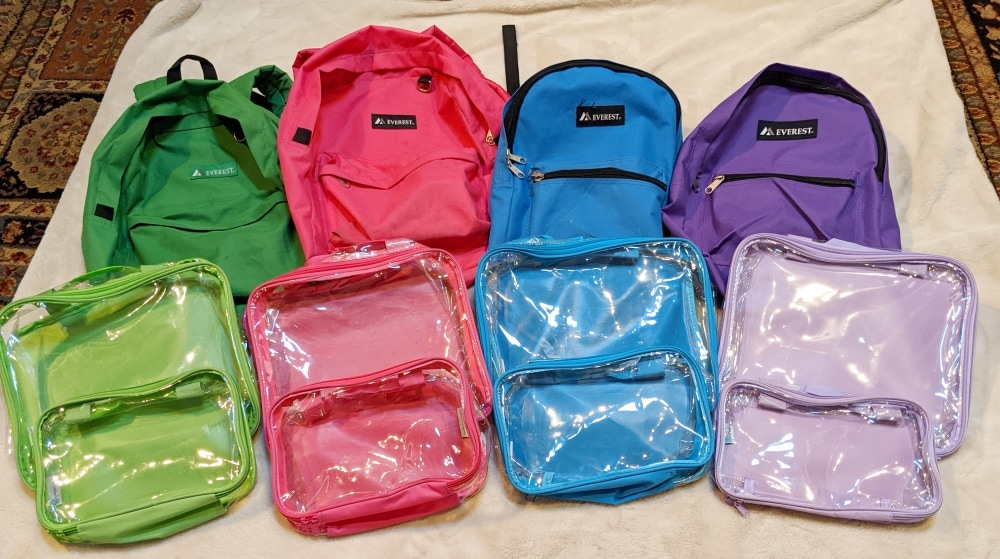 color-coded backpacks and packing cubes
