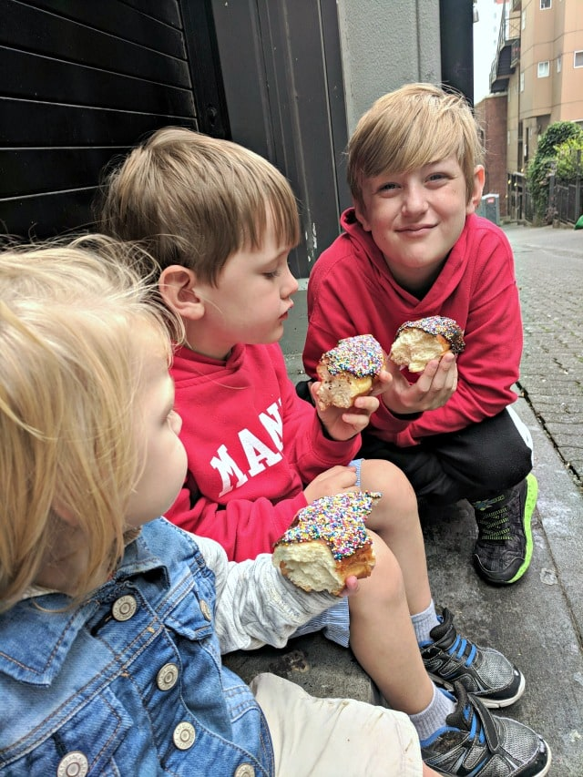 kids eating donut in Pike Place Market