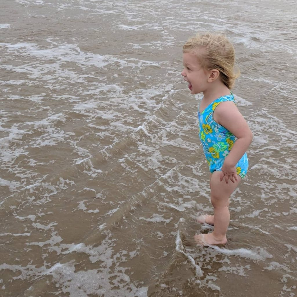 little girl in the surf