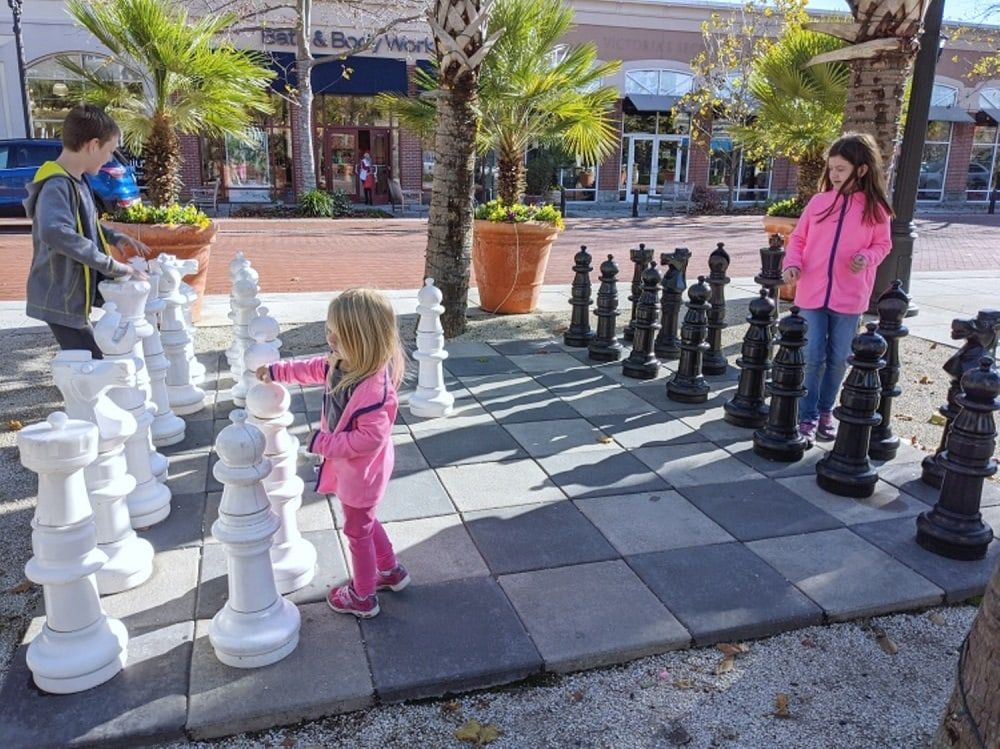 kids playing giant chess