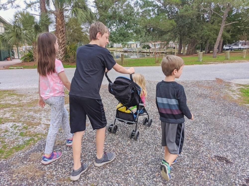 four kids on a walk