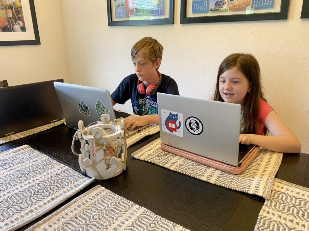 big kids on laptops