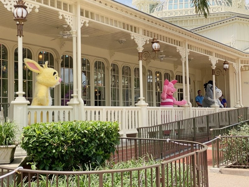 characters waving from porch